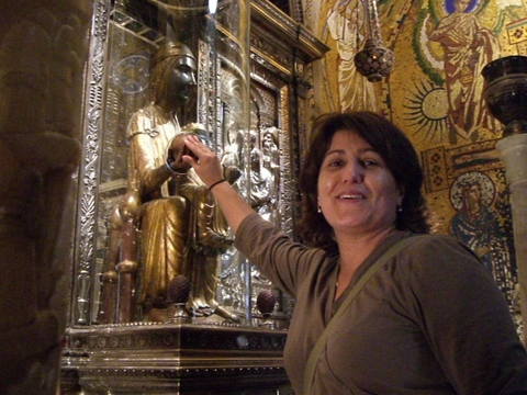 Vic touching the right hand of the Black Madonna.